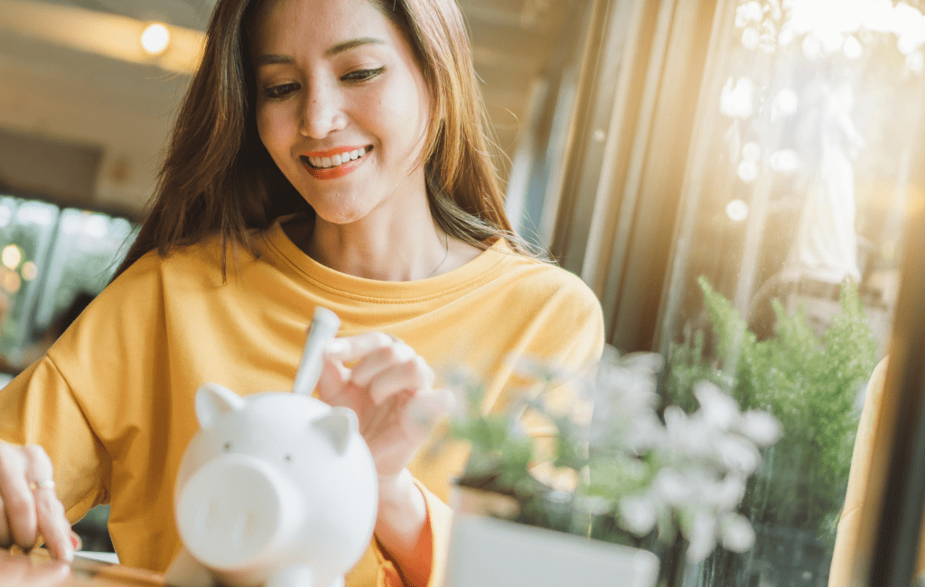 can't afford to save money - woman piggy bank